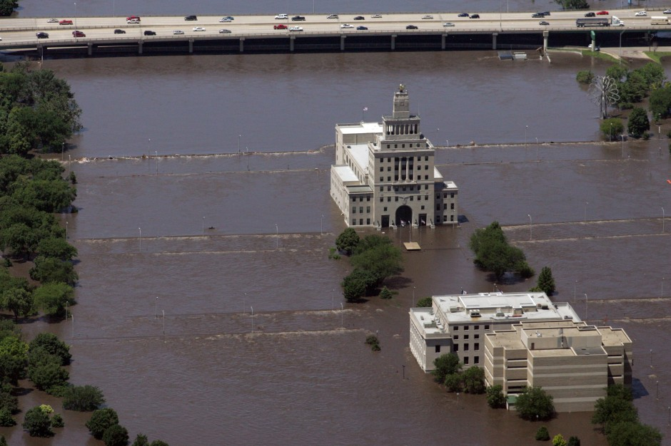 Mays Island, which holds Cedar Rapids court house, is now submerged under flood water after the Cedar River overflowed its banks, Friday, June 13, 2008 in Cedar Rapids, Iowa. For decades, Cedar Rapids escaped any major, widespread flooding, even during the Midwest deluge of 1993, and many people had grown confident that rising water would pose no danger to their city. The flood this time didn
